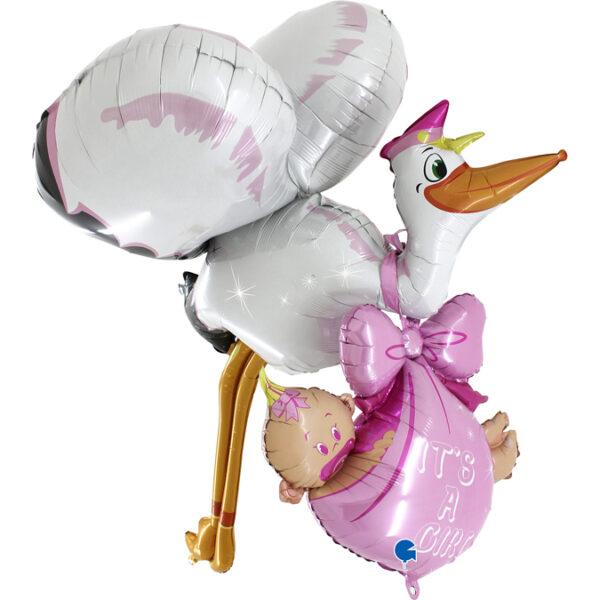 Gigantyczny balon w kształcie bociana niosącego dziecko